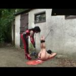 Mistress In Scene: Kinky and sadistic latex Mistress suspends her slave outdoors and uses a very large dildo to fuck his slave ass – FEMDOMLOFT – LQ/238p/MP4
