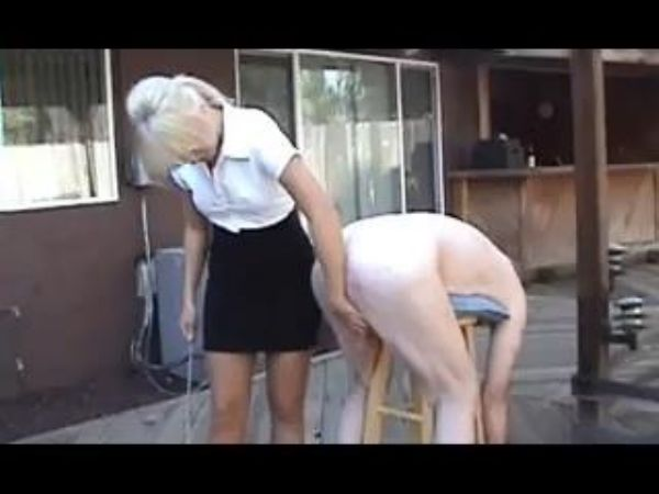 Mature Mistress In Scene: Mature blonde disciplinarian in skirt and blouse ties up a male on a wooden stool and canes his sorry ass - WOMENWHOPUNISH - LQ/240p/MP4