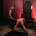 Latex clad Mistress in thigh high boots delivers a hot and harsh caning on slave's ass – WOMENWHOPUNISH – SD/576p/MP4