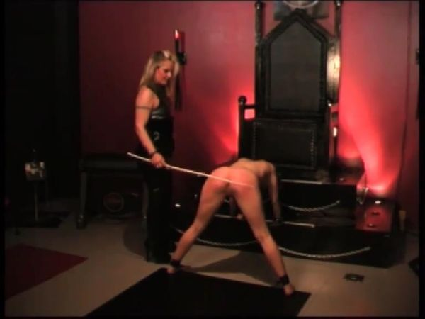 Latex clad Mistress in thigh high boots delivers a hot and harsh caning on slave's ass - WOMENWHOPUNISH - SD/576p/MP4